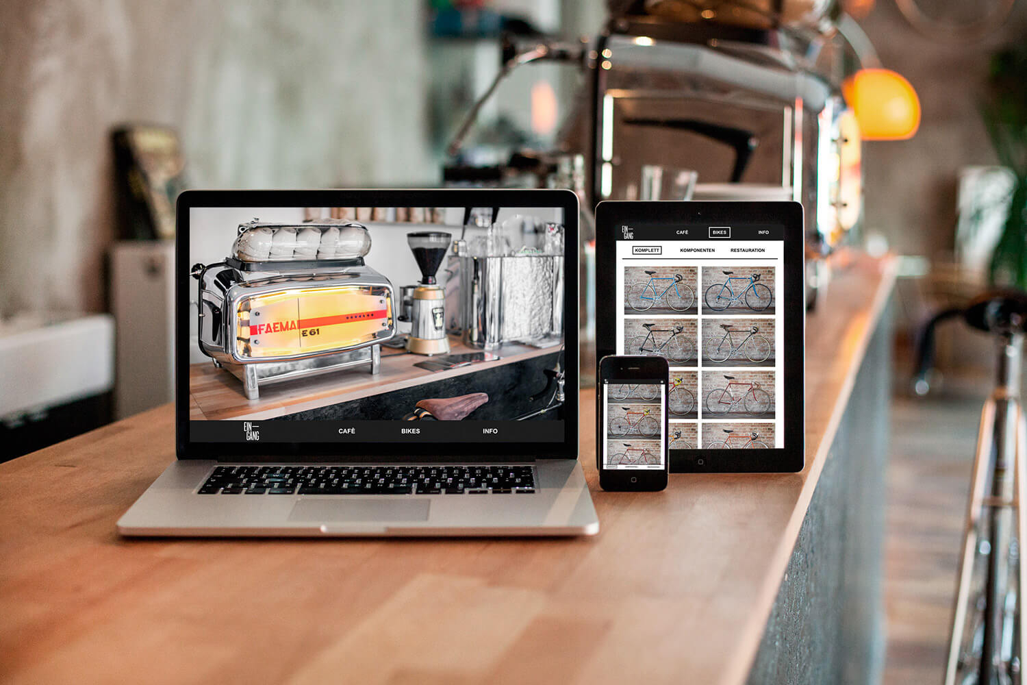Photo of the responsive website design for Café Eingang shown on a mobile, tablet and desktop screen.